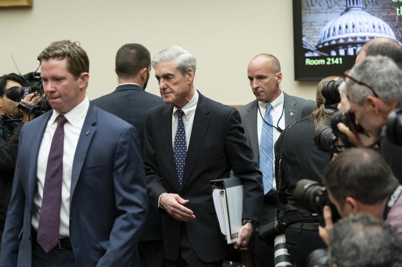 Escorted by a security detail, former special counsel Robert Mueller arrives to testify to the House Judiciary Committee about his investigation into President Donald Trump and Russian interference in the 2016 election, on Capitol Hill in Washington, Wednesday, July 24, 2019. Mueller told lawmakers he could not exonerate President Donald Trump of obstruction of justice and that the president's claims that he had done so in his report are not correct. (AP Photo/J. Scott Applewhite)