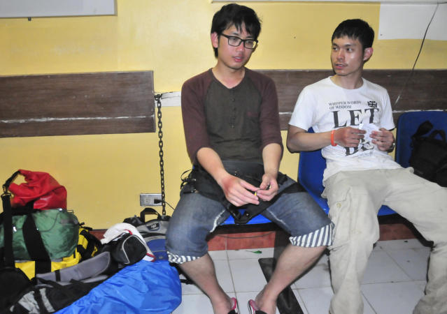 Thai nationals, Nithi Rvangpisit, left, and Tanut Rvchippiyarak, rest in a hospital in Legazpi city with their mountain climbing gear after surviving a steam-driven explosion of Mayon volcano, one of the Philippines' most active volcanoes, Tuesday, May 7, 2013 in Albay province, about 450 kilometers (285 Miles) southeast of Manila, Philippines. Mayon volcano rumbled to life Tuesday, spewing room-sized rocks toward nearly 30 surprised climbers, killing five and injuring others that had to be fetched with rescue helicopters and rope. (AP Photo/Nelson Salting)