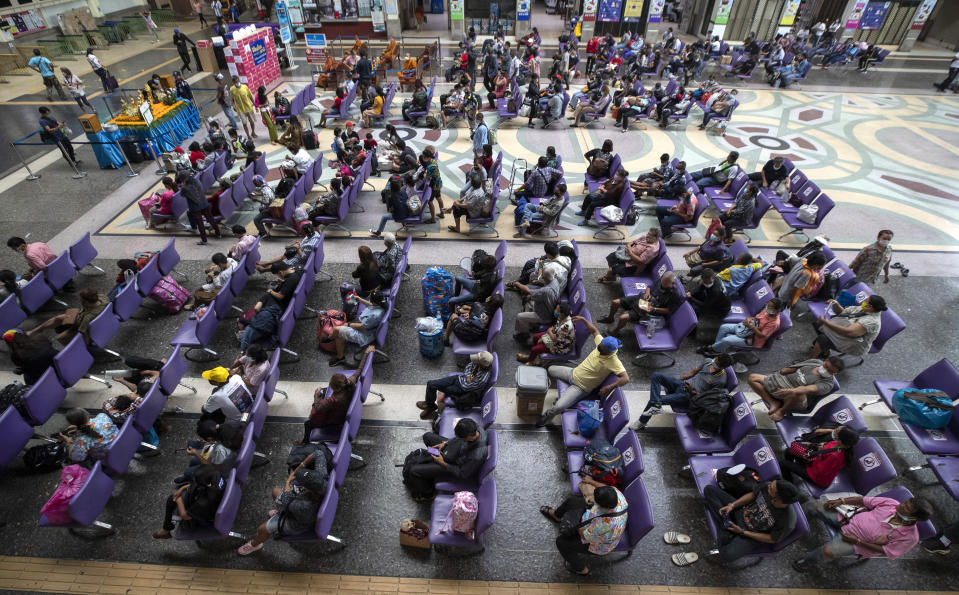 Passengers sit in waiting room at Hua Lamphong Railway Station in Bangkok, Thailand, Friday, April 9, 2021. Thai authorities were struggling Friday to contain a growing coronavirus outbreak just days before the country's traditional Songkran New Year's holiday, when millions of people travel around the country. (AP Photo/Sakchai Lalit)