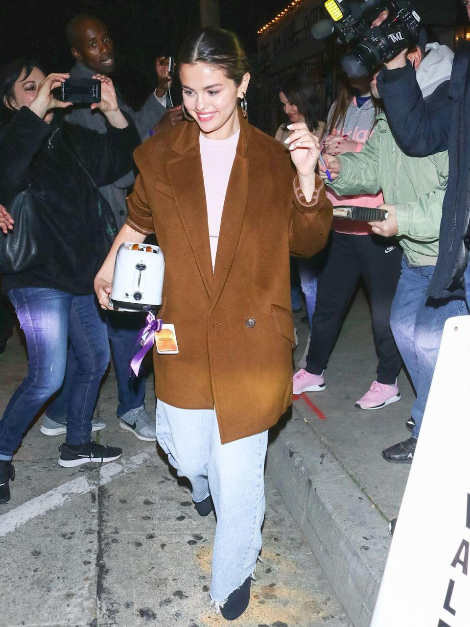 <p>A baggy jean and oversized blazer are peak comfort. Keep the look polished with hoops and a slicked-back bun. </p>