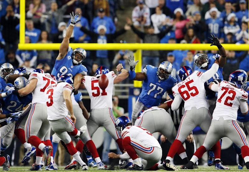 New York Giants kicker Josh Brown (3) kicks a 45-yard field goal during the overtime period of an NFL football game against the Detroit Lions in Detroit, Sunday, Dec. 22, 2013. The Giants won 23-20. (AP Photo/Paul Sancya)