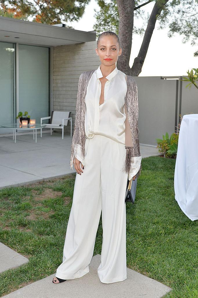 <p>White on white with a hit of silver fringe. <i>(Photo by Stefanie Keenan/Getty Images for NET-A-PORTER)</i><br></p>
