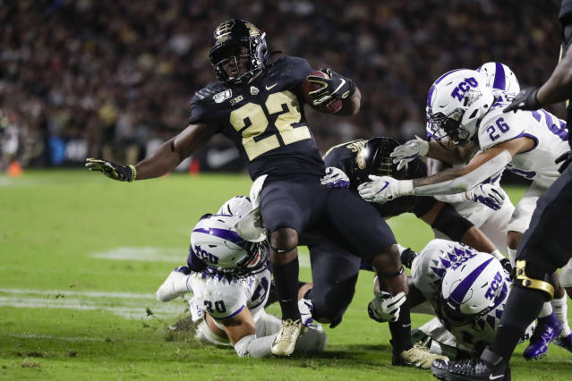 Purdue running back King Doerue (22) is tackled by TCU linebacker Garret Wallow (30), safety Vernon Scott (26) and another defender during the second half of an NCAA college football game in West Lafayette, Ind., Saturday, Sept. 14, 2019. (AP Photo/Michael Conroy)