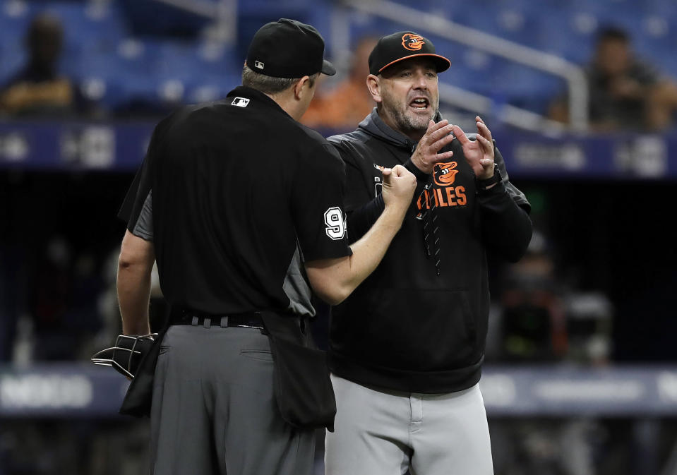 Baltimore Orioles manager Brandon Hyde, right, argues with home plate umpire Lance Barrett after Richie Martin was called out at first during the third inning of the second baseball game of the team's doubleheader against the Tampa Bay Rays on Tuesday, Sept. 3, 2019, in St. Petersburg, Fla. (AP Photo/Chris O'Meara)
