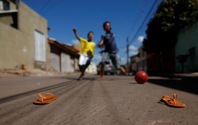 Children play soccer before the World Cup Group E soccer match between Brazil and Switzerland, at Sao Sebastiao neighbourhood in Brasilia,Brazil June 17, 2018. REUTERS/Adriano Machado