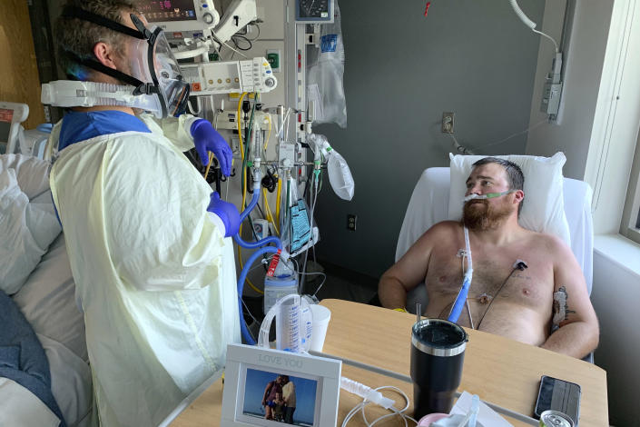 Registered Nurse Chris Murphy walks 31-year-old Daryl Barker through breathing techniques inside Lake Regional Hospital's Intensive Care Unit on Monday, July 26, 2021, in Osage Beach, Mo. Murphy, an Army veteran who served as a Combat Medic in Iraq often leans on the resiliency he learned in the military to fight off mental fatigue. (AP Photo/Sarah Blake Morgan)