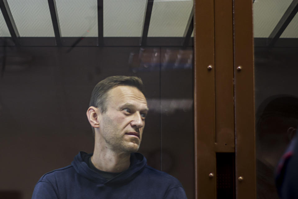 "In this photo provided by the Babuskinsky District Court, Russian opposition leader Alexei Navalny stands in a cage during a hearing on his charges for defamation, in the Babuskinsky District Court in Moscow, Russia, Friday, Feb. 5, 2021. The European Union's top diplomat has told Russia's foreign minister that the treatment of Russian opposition leader Alexei Navalny represents ""a low point"" in the relations between Brussels and Moscow. EU foreign affairs chief Josep Borrell met with Russian Foreign Minister Sergey Lavrov in Moscow days after Navalny was ordered to serve nearly three years in prison. (Babuskinsky District Court Press Service via AP)"