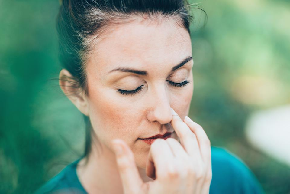 Breathing exercise Pranayama - Alternate nostril breathing, often performed for stress and anxiety relief