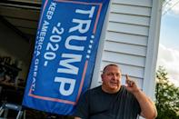 David Mitchko says he has handed out some 14,000 pro-Trump lawn signs and bumper stickers to everyone from police officers to priests