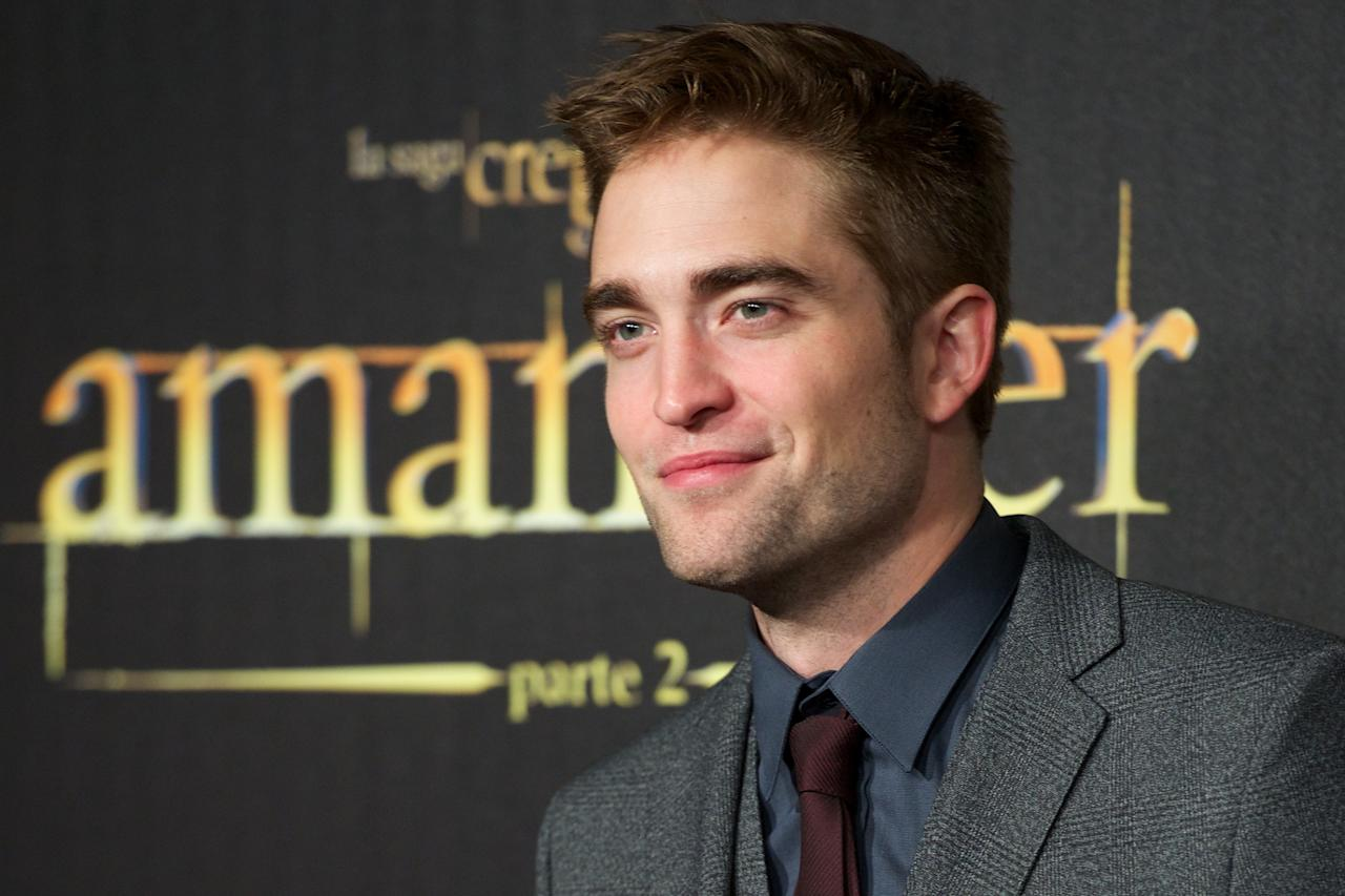 "MADRID, SPAIN - NOVEMBER 15:  Actor Robert Pattinson attends the ""The Twilight Saga: Breaking Dawn - Part 2"" (La Saga Crepusculo: Amanecer Parte 2) premiere at the Kinepolis cinema on November 15, 2012 in Madrid, Spain.  (Photo by Carlos Alvarez/Getty Images)"