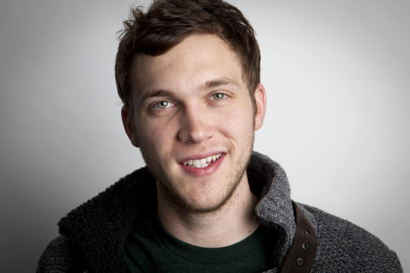 """In this Tuesday, Nov. 13, 2012 photo, American singer-songwriter and winner of the eleventh season of American Idol, Phillip Phillips, Jr. poses for a portrait in New York. In true """"American Idol"""" fashion where winners need to strike while the iron's hot, Phillips didn't have a lot of time to record his debut album, """"The World From the Side of the Moon,"""" which is now in stores. In fact, he only had three weeks. (Photo by Amy Sussman/Invision/AP)"""