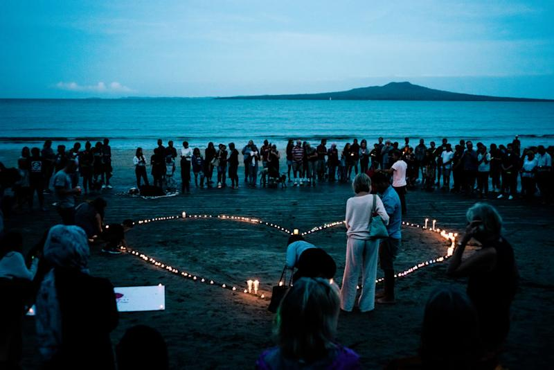 Crowds gather on Takapuna beach for a vigil in memory of the victims of the Christchurch mosque terror attacks, Auckland, New Zealand, March 16, 2019.