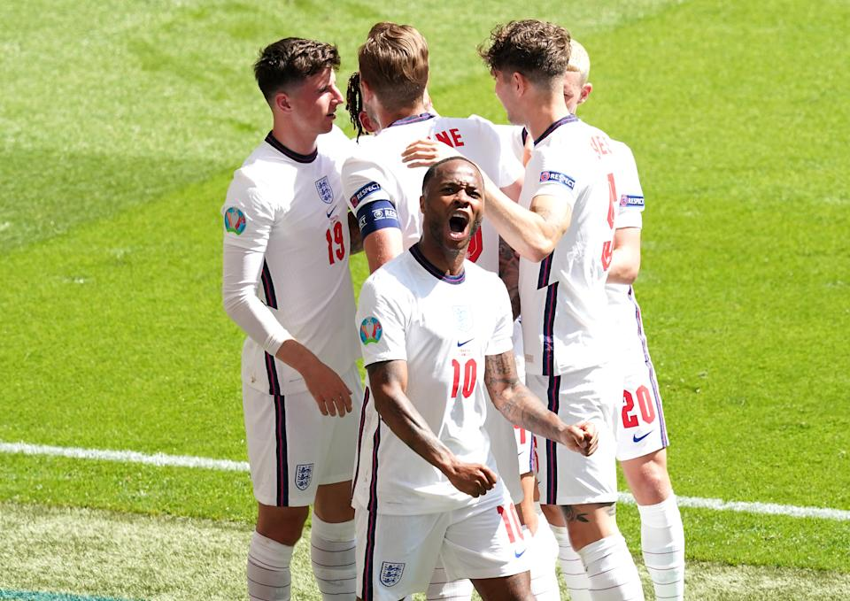 England's Raheem Sterling (centre) celebrates scoring their side's first goal of the game with team-mates during the UEFA Euro 2020 Group D match at Wembley Stadium, London. Picture date: Sunday June 13, 2021. (Photo by Martin Rickett/PA Images via Getty Images)