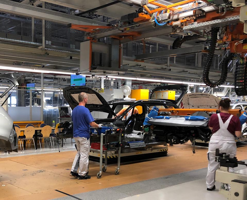 Workers install dashboards in Volkswagen ID.3 cars at the automaker's Zwickau assembly plant in Zwickau, Germany, September 13, 2019. Picture taken September 13, 2019. REUTERS/Joe White