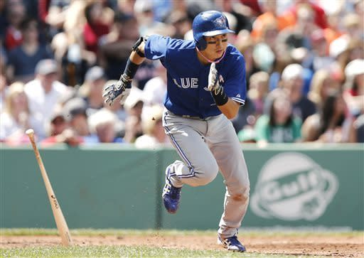Toronto Blue Jays' Munenori Kawasaki, of Japan, runs out a two-run single against the Boston Red Sox during the second inning of a baseball game at Fenway Park in Boston, Sunday, May 12, 2013. (AP Photo/Winslow Townson)