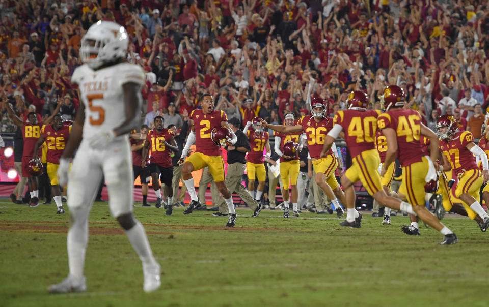 USC players celebrate after the game-winning field goal against Texas on Saturday. (AP)