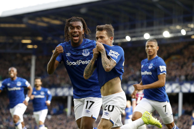 Bernard celebrates with team mate Alex Iwobi (Photo by Martin Rickett/PA Images via Getty Images)