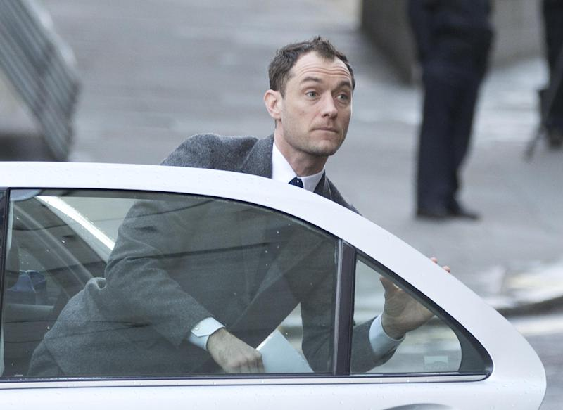 British actor Jude Law arrives at The Old Bailey law court in to give evidence at the phone hacking trial in London, Monday, Jan. 27, 2014. Former News of the World national newspaper editors Rebekah Brooks and Andy Coulson are, along with several others, on trial for charges relating to the hacking of phones and bribing officials while they were employed at the now closed tabloid paper.(AP Photo/Alastair Grant)