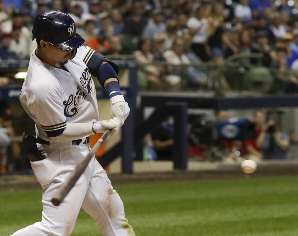 Milwaukee Brewers' Keston Hiura hits an RBI double during the eighth inning of a baseball game against the San Francisco Giants Saturday, July 13, 2019, in Milwaukee. (AP Photo/Morry Gash)