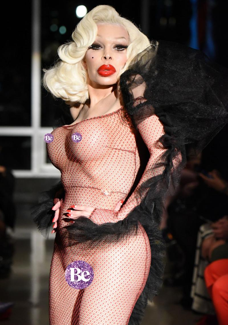 Transgender model Amanda Lepore had heads turning this week, when she hit the catwalk at the Kaimin show in a completely see-through outfit at New York Fashion Week. Source: Getty