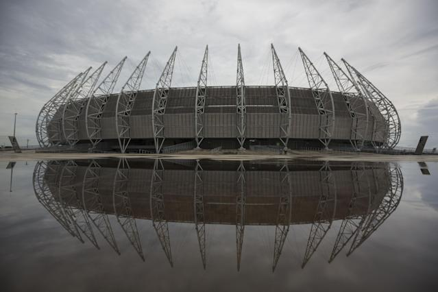 The Castelao stadium is reflected in water after heavy rains in Fortaleza, Brazil, Monday, April 28, 2014. Castelao will host matches during the 2014 World Cup soccer tournament. (AP Photo/Felipe Dana)