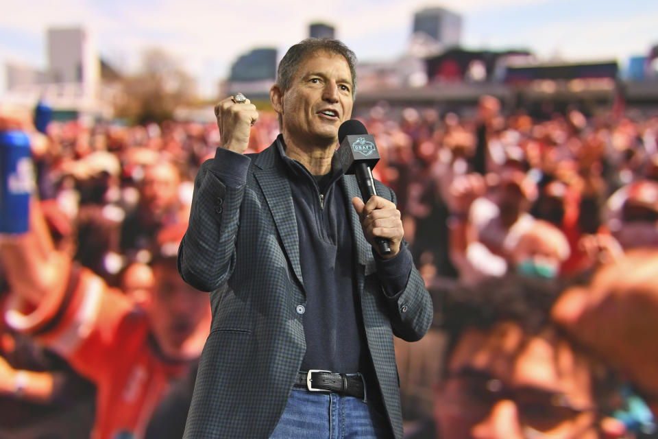 Former Cleveland Browns quarterback Bernie Kosar speaks to fans during the fourth round of the NFL football draft, Saturday, May 1, 2021, in Cleveland. (AP Photo/David Dermer)
