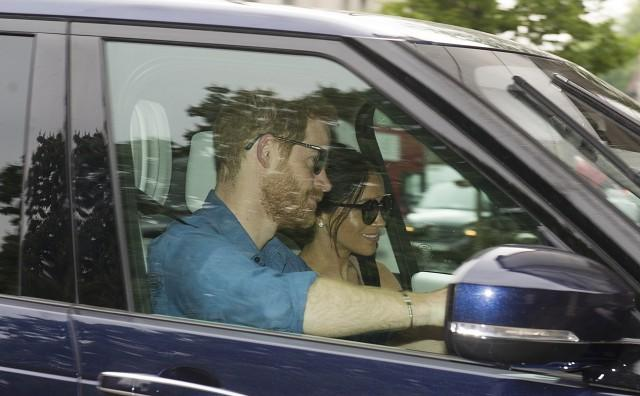 Prince Harry and Meghan Markle return to Kensington following royal wedding weekend