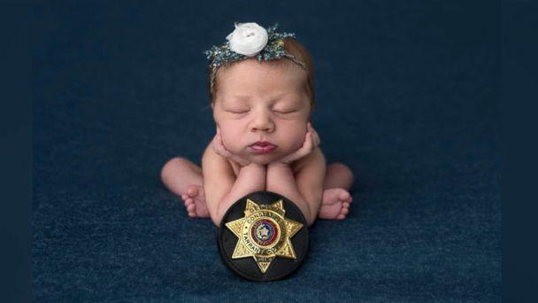 PHOTO: Evelyn Joy Deborah Hall was born on July 18 in Texas after Officer Mark Diebold of the Tarrant County police helped deliver the newborn for parents Destiny and Caleb Hall of Granbury, Texas, after Destiny went into labor en route to the hospital.  (Cyndi Williams Photography )