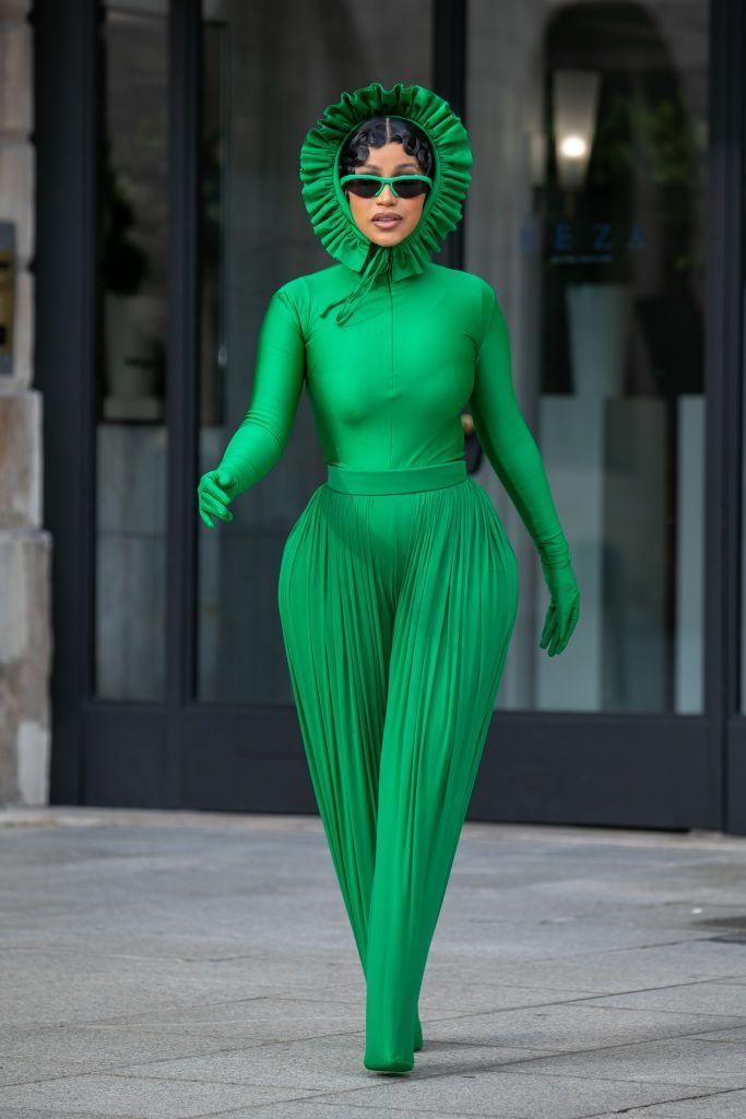 """<p>The now mother-of-two wore a fresh-off-the-runway <a href=""""https://www.elle.com/uk/fashion/trends/a37616716/kelly-green-colour-trend/"""" rel=""""nofollow noopener"""" target=""""_blank"""" data-ylk=""""slk:Kelly green"""" class=""""link rapid-noclick-resp"""">Kelly green</a> look by Richard Quinn while out and about during <a href=""""https://www.elle.com/uk/paris-fashion-week/"""" rel=""""nofollow noopener"""" target=""""_blank"""" data-ylk=""""slk:Paris Fashion Week"""" class=""""link rapid-noclick-resp"""">Paris Fashion Week</a>. </p>"""