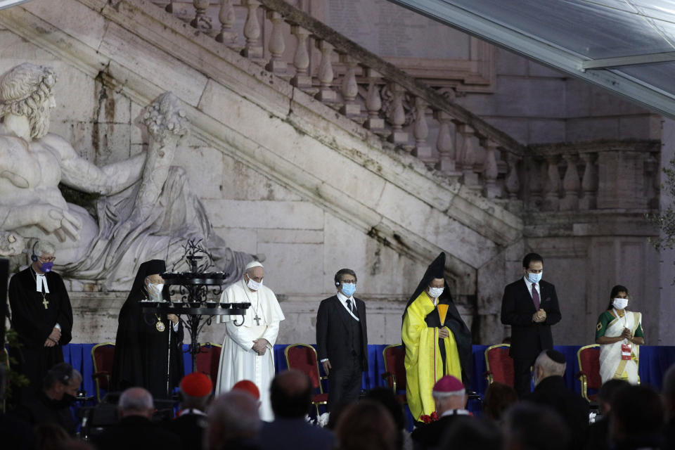 Pope Francis and other representatives of other religions honor the victims of COVID-19 pandemic with a minute of silence during an inter-religious ceremony for peace in the square outside Rome's City Hall, Tuesday, Oct. 20, 2020 (AP Photo/Gregorio Borgia)