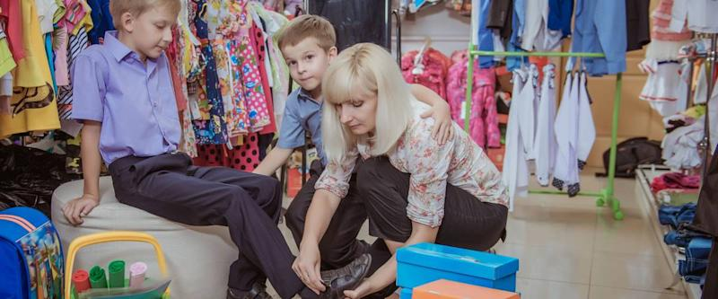 young beautiful woman with children in shop