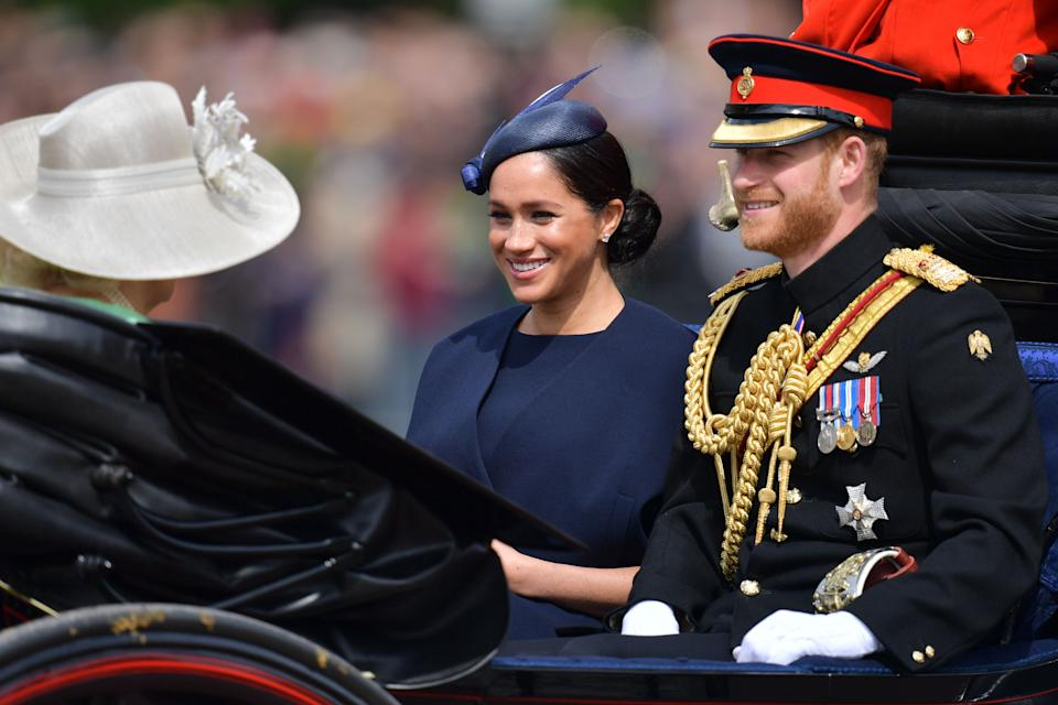 Britain's Meghan, Duchess of Sussex (C) and Britain's Prince Harry, Duke of Sussex (R) make their way in a horse drawn carriage to Horseguards parade ahead of the Queen's Birthday Parade, 'Trooping the Colour', in London on June 8, 2019. - The ceremony of Trooping the Colour is believed to have first been performed during the reign of King Charles II. Since 1748, the Trooping of the Colour has marked the official birthday of the British Sovereign. Over 1400 parading soldiers, almost 300 horses and 400 musicians take part in the event. (Photo by Daniel LEAL-OLIVAS / AFP)        (Photo credit should read DANIEL LEAL-OLIVAS/AFP via Getty Images)