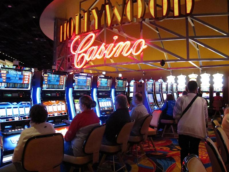 Gamblers play the slot machines as the new Hollywood Casino Columbus opens Monday Oct. 8, 2012, in Columbus, Ohio. The $400 million Hollywood Casino Columbus is expected to draw 3 million visitors annually. (AP Photo/Kantele Franko.)