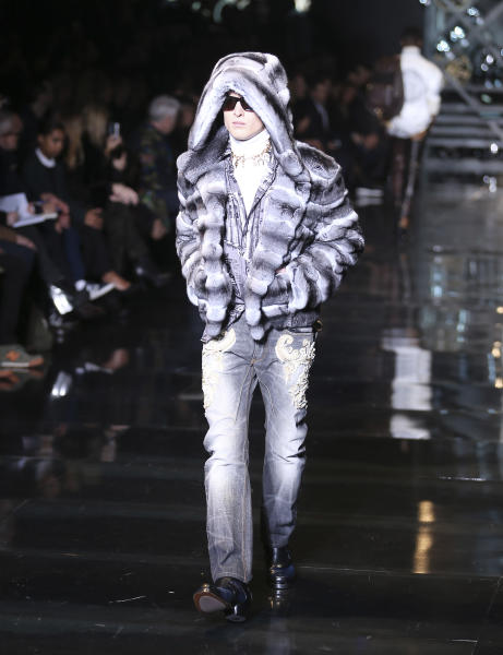 A model wears a creation for Versace men's Autumn-Winter 2014 collection, part of the Milan Fashion Week, unveiled in Milan, Italy, Saturday, Jan. 11, 2014. (AP Photo/Antonio Calanni)