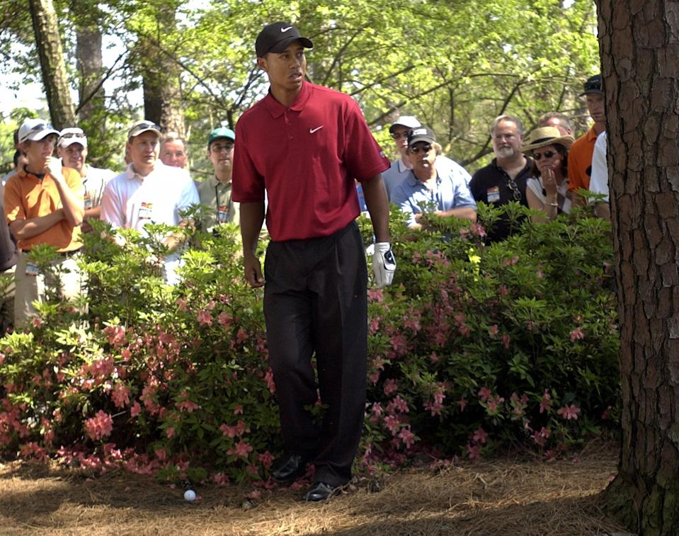 <p>Tiger Woods checks his shot after getting in trouble on the third hole during final round play of the 2003 Masters at the Augusta National Golf Club in Augusta, Ga., Sunday, April 13, 2003. (AP Photo/David J. Phillip) </p>