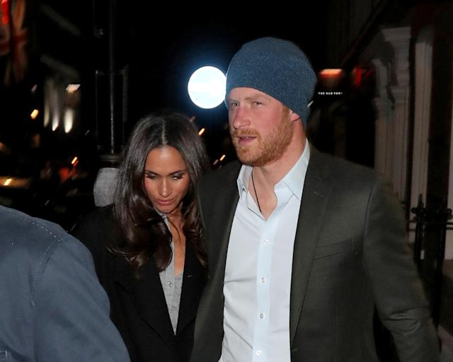 <p>The couple was officially photographed for the first time in February, after having a dinner date at London's Soho House. Harry held Markle's hand as the duo was swarmed by waiting paparazzi.<br>(Photo: FameFlynet) </p>