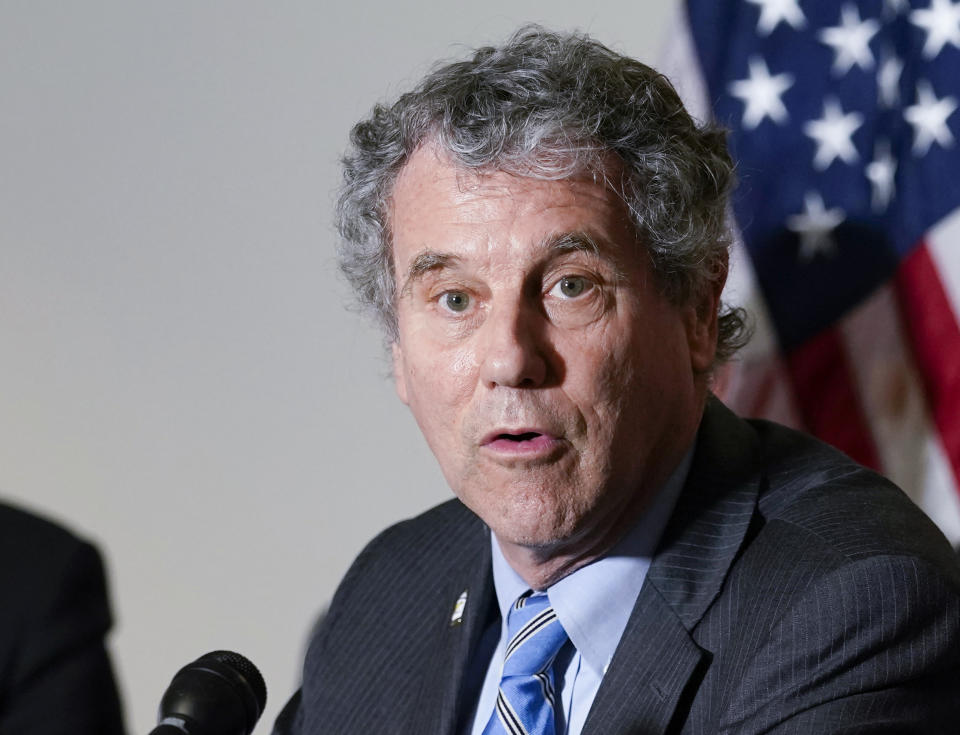 FILE - This May 18, 2021 file photo Sen. Sherrod Brown, D-Ohio, speaks on Capitol Hill in Washington.  The heads of the nation's big Wall Street firms were back on Capitol Hill Tuesday, May 26, the start of two days of hearings where the big banks are expected to be scolded by members of Congress on both sides of the aisle over issues like inequality and the corporate culture of Wall Street.  A self-described progressive, Brown said that when he became chair of the committee earlier this year, he planned to subpoena the CEOs to testify as soon as he could. (AP Photo/Susan Walsh, File)