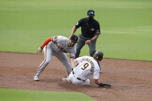 San Diego Padres Jake Cronenworth is tagged out by San Francisco Giants Evan Longoria after attempting to steal second base in the second inning of a baseball game Sunday, Sept. 13, 2020, in San Diego. (AP Photo/Derrick Tuskan)