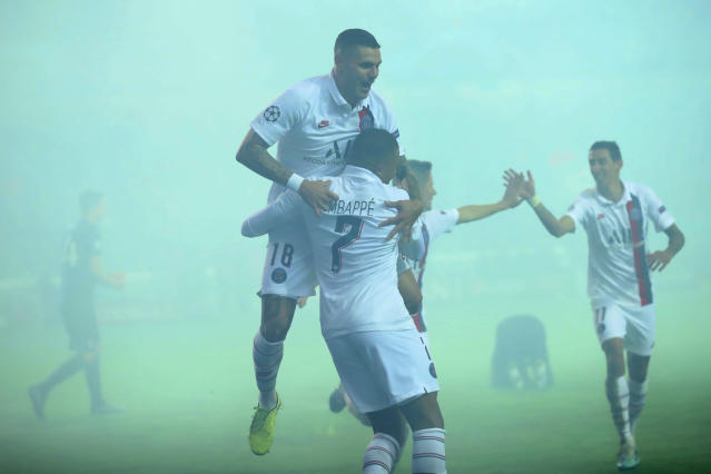 PSG's Kylian Mbappe, center, celebrates with teammates after he scored during a Champions League Group A soccer match between Club Brugge and Paris Saint Germain at the Jan Breydel stadium in Bruges, Belgium, Tuesday, Oct. 22, 2019. (AP Photo/Francisco Seco)