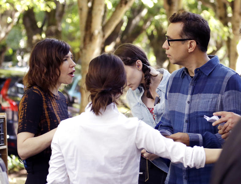 """This Sept. 18, 2015 photo shows Fred Armisen, right, with co-star Carrie Brownstein, left, during the filming of their series, """"Portlandia,"""" in Portland, Ore. Brownstein and Armisen conceived the series with fellow executive producer Jonathan Krisel, and the two of them play various and sundry characters.(AP Photo/Don Ryan)"""
