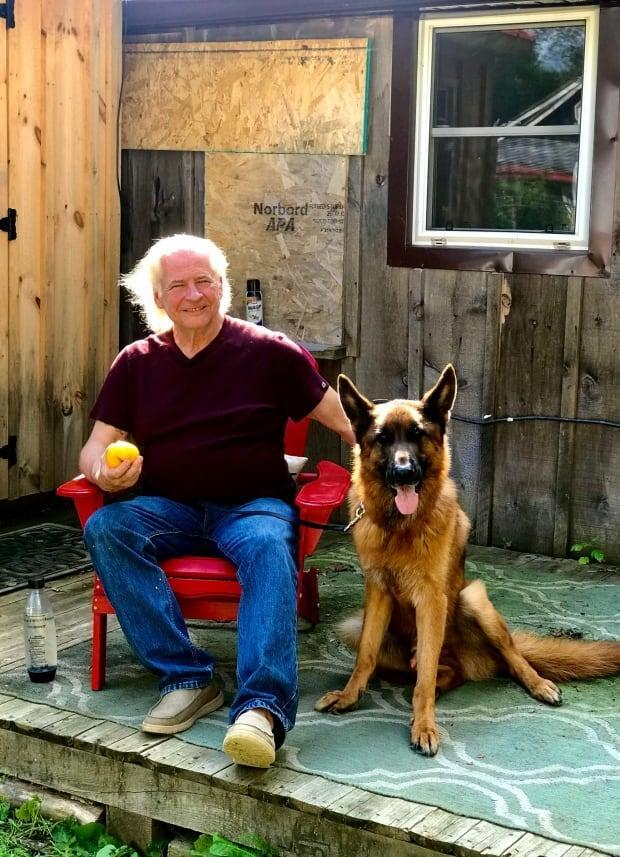 Ralph Thistle, pictured here with his service dog Rupert, thought his 14-year battle for PTSD compensation was over. It may not be now that the Toronto Police Service wants to take a closer a look at the $630,000 it's been ordered to pay. (Chris Gargus/CBC News - image credit)