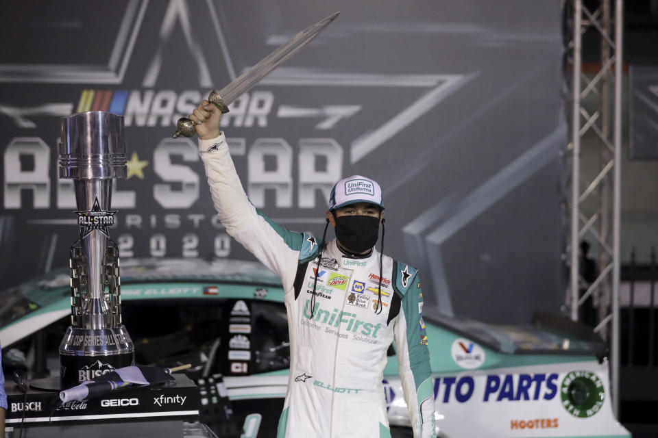 Chase Elliott celebrates with the trophy after winning a NASCAR All-Star auto race at Bristol Motor Speedway in Bristol, Tenn, Wednesday, July 15, 2020. (AP Photo/Mark Humphrey)
