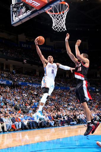 OKLAHOMA CITY, OK - NOVEMBER 2: Russell Westbrook #0 of the Oklahoma City Thunder goes to the basket against Nicolas Batum #88 of the Portland Trail Blazers on November 2, 2012 at the Chesapeake Energy Arena in Oklahoma City, Oklahoma. (Photo by Layne Murdoch/NBAE via Getty Images)