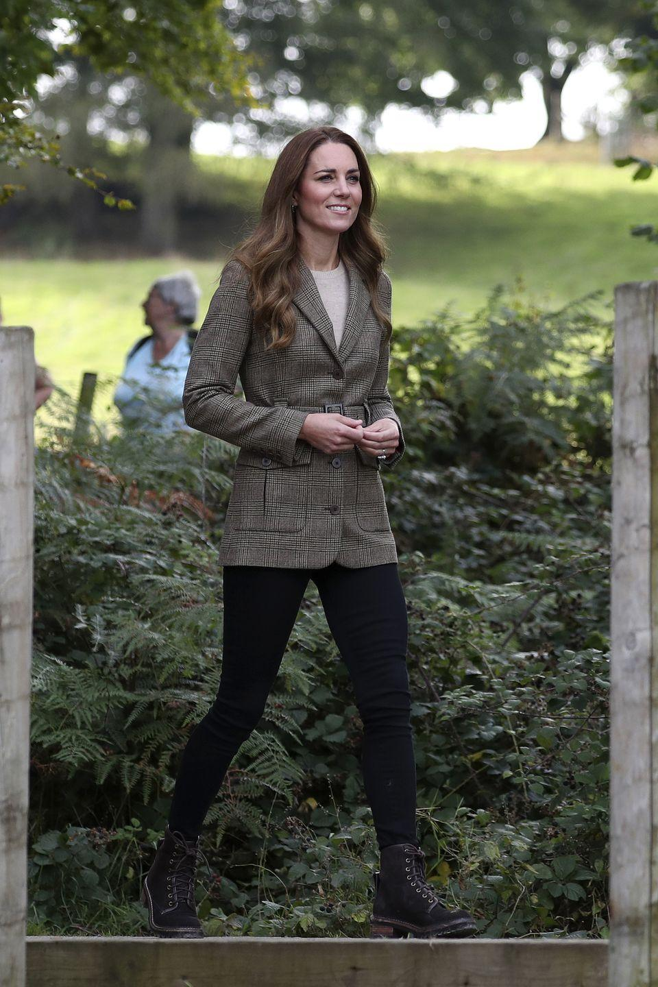 """<p>The Duchess of Cambridge looked <a href=""""https://www.townandcountrymag.com/society/tradition/a37677504/kate-middleton-preppy-fall-blazer-outfit-photos/"""" rel=""""nofollow noopener"""" target=""""_blank"""" data-ylk=""""slk:ready for fall"""" class=""""link rapid-noclick-resp"""">ready for fall</a> in a chic belted, plaid blazer, skinny jeans, and combat boots, while heading on a boat ride. </p>"""