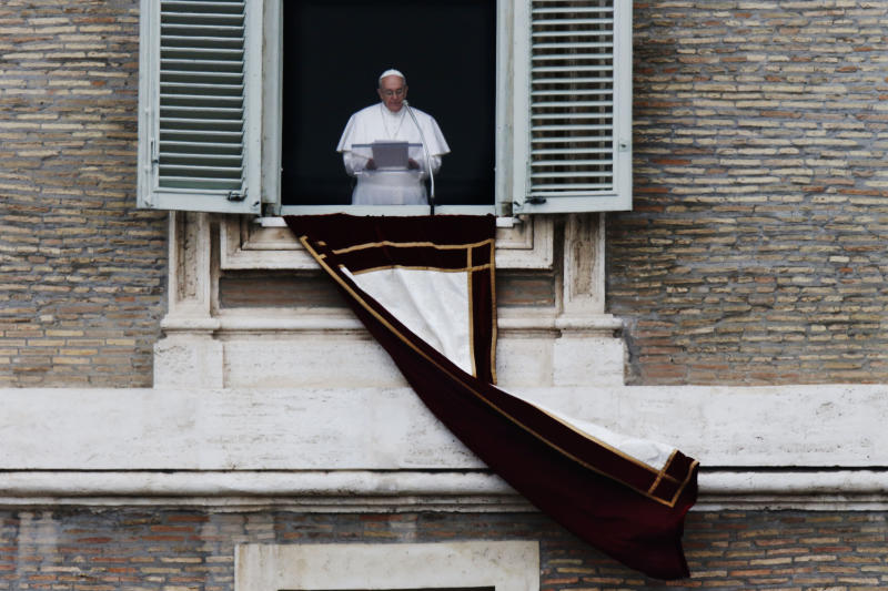 Pope Francis recites the Angelus prayer to the crowd in St. Peter's Square at the Vatican, Sunday, March 17, 2013.(AP Photo/Dmitry Lovetsky)