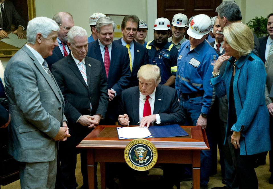 """President Donald Trump signs H.J. Res. 38, disapproving the rule submitted by the US Department of the Interior known as the Stream Protection Rule in 2017. The Obama administration had passed the rule, which """"addresses the impacts of surface coal mining operations on surface water, groundwater, and the productivity of mining operation sites,"""" according to the Congress.gov summary of the resolution."""