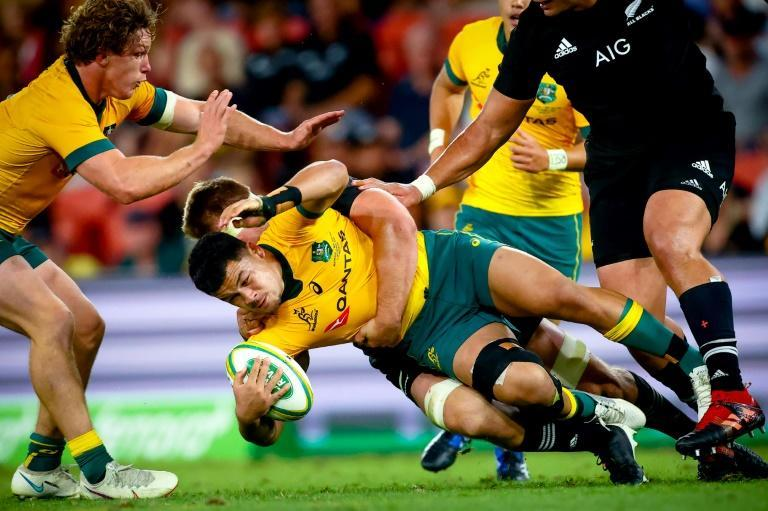 New Zealand captain Sam Cane tackles Noah Lolesio during the Wallabies stunning victory in Brisbane. Wallabies coach Dave Rennie says he will not be getting carried away with the win