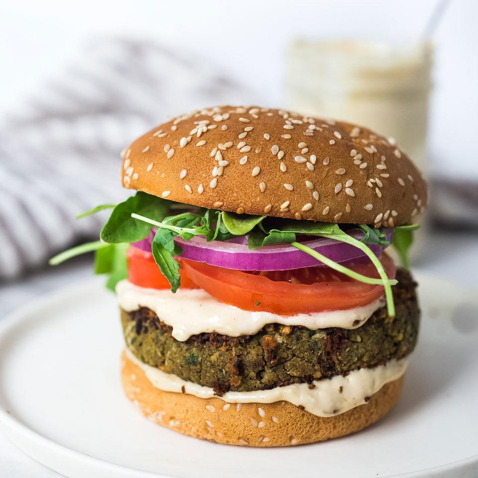"""<p>Pureed chickpeas, seasoned with the characteristic flavors of falafel, make excellent veggie burgers. We use a two-stage method for cooking the patties, first browning them in a skillet and then finishing them in the oven. Garnish the burgers with tzatziki or tahini sauce (see associated recipes), pickled red onions, lettuce and tomatoes. <a href=""""http://www.eatingwell.com/recipe/268214/falafel-burgers/"""" rel=""""nofollow noopener"""" target=""""_blank"""" data-ylk=""""slk:View recipe"""" class=""""link rapid-noclick-resp""""> View recipe </a></p>"""