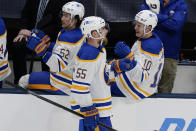 Buffalo Sabres' Rasmus Ristolainen (55) celebrates with teammates after scoring a goal during the third period of the team's NHL hockey game against the New York Islanders on Thursday, March 4, 2021, in Uniondale, N.Y. (AP Photo/Frank Franklin II)