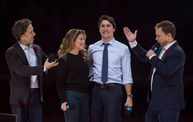 Trudeau and his wife, Sophie Grégoire-Trudeau, are flanked by WE Charity co-founders Craig Kielburger, left, and his brother, Marc, at WE Day celebrations in Ottawa in 2015.